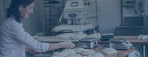woman in bakery working